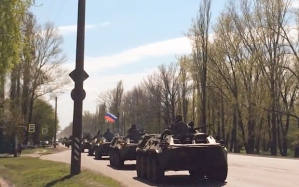 Russian troops driving tanks to the border with Ukraine in April 2014