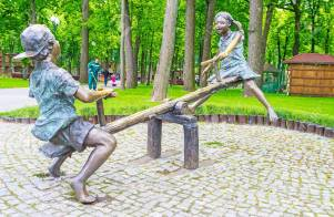 KHARKiV, UKRAINE - MAY 20, 2016: The bronze sculpture of children, playing on a seesaw, Gorky Park, on May 20 in Kharkiv.