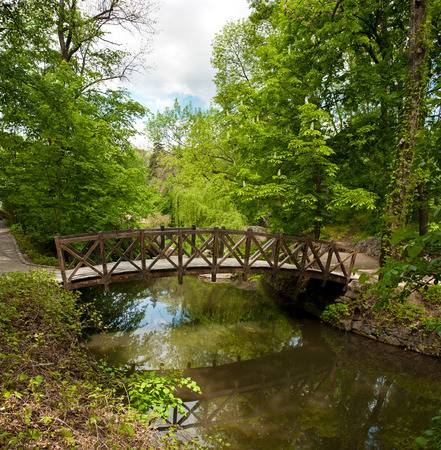 81212378-wooden-footbridge-across-river-in-sofiyivsky-park-in-uman-ukraine